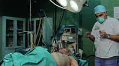 Anesthetist, anesthesiologist preparing patient for knee operation. Stock Footage