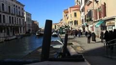 Pleasure cruiser passes tourists in Venice Stock Footage
