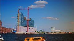 A ferry boat on the River Elbe,Hamburg Hafencity with the Elbphilharmonie. Stock Footage