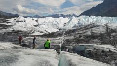 Glacial Crevasse to Scenic Tourists on Matanuska Glacier tilt up zoom out Stock Footage
