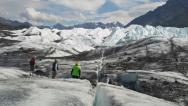 Stock Video Footage of Glacial Crevasse to Scenic Tourists on Matanuska Glacier tilt up zoom out