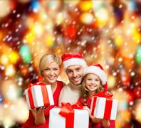 smiling family giving many gift boxes - stock illustration