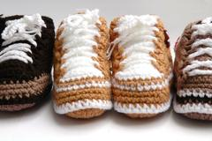 Baby yarn shoes Stock Photos