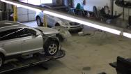 Stock Video Footage of PAN HIGH BUSY AUTOMOTIVE REPAIR SHOP.