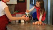 Stock Video Footage of PREGNANT MOM BAKING WITH LITTLE GIRL STIRRING