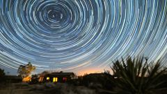 Incredible Star Trails time-lapse over Desert Cabin Night to Sunrise Stock Footage