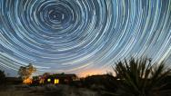 Stock Video Footage of Incredible Star Trails time-lapse over Desert Cabin Night to Sunrise