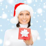 woman in santa helper hat with small gift box - stock illustration