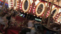 Empty Merry-Go-Round Horses at Night Stock Footage