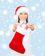 Stock Illustration of smiling woman with small giftbox and stocking