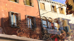 Venice apartment building reflected in mask shop window Stock Footage