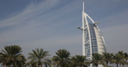 Stock Video Footage of Ultra HD 4K Burj Al Arab Landmark United Arab Emirates Dubai Exotic Palm Trees