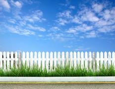 white fence and blue sky - stock illustration
