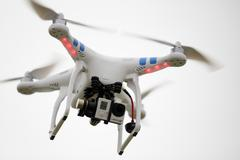 Photo of a quadcopter with a gopro camera Stock Photos