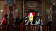 Stock Video Footage of Worship  to the Sacred Tooth Relic of Buddha. Kandy, Sri Lanka.