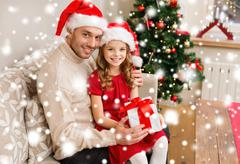 smiling father and daughter holding gift box - stock illustration