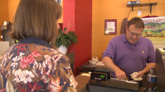 Cafe customer at the counter to pay cashier Stock Footage