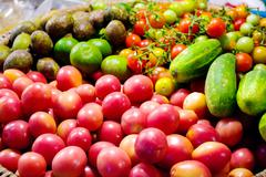 tomatoes and vegetables  in a basket - stock photo