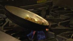 Cafe cook making stirfry 2shot CU MCU Stock Footage