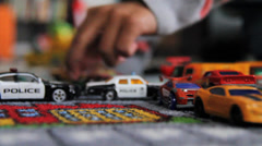 Low Angle Shot of Boy Playing with Cars Stock Footage