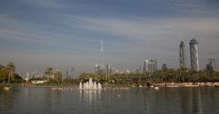 Ultra HD 4K Safa Park Dubai Skyline Burj Khalifa People Enjoy Holiday Boat Ride Stock Footage