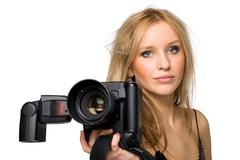 Portrait of a beautiful young blond female with camera, isolated on white. Stock Photos