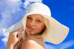 Young girl under hat in summer Stock Photos