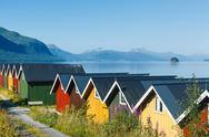 Stock Photo of Colorful camping cabins on the fjord shore