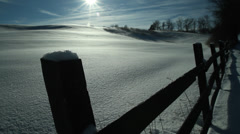 Winter, wood fence, fresh snow, blue sky, sun Stock Footage