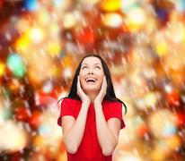 amazed laughing young woman in red dress - stock illustration