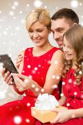 smiling family with tablet pc - stock illustration