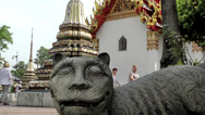 Stock Video Footage of Thailand Bangkok 033 stone cat figure in yard of wat pho temple