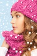 beautiful woman in pink winter hat and muffler - stock illustration