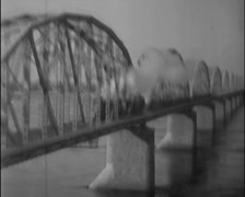 1932 - Train Crossing Steel Brigde 01 Stock Footage