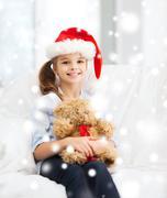 Smiling girl in santa helper hat with teddy bear Stock Illustration