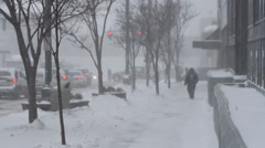Blizzard in the city, winter, people walking through snow Stock Footage