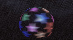 Spinning star globe in the rain Stock Footage