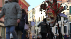 Hanging Venice mask, tourists out of focus Stock Footage
