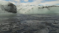 Stock Video Footage of Glacier Meltwater Channel Ice and Till Gravel CU low Angle