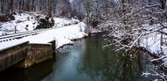 Stock Photo of railroad tracks and creek during the winter, in rural carroll county, maryland