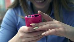 Businesswoman hands texting, sending sms on smartphone HD - stock footage