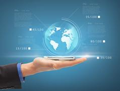 Man hand with smartphone and virtual sphere globe Stock Photos