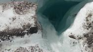 Stock Video Footage of Glacier Meltwater Gushing into Glacial Crevasse Moulin pan