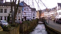 Tourists in small German town (Bad Munstereifel). - stock footage