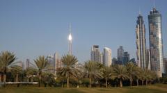 JW Marriott Marquis Hotel Burj Khalifa Dubai Skyline Safa Park People Walking Stock Footage