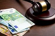 Stock Photo of judge gavel with euro bills