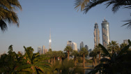 Stock Video Footage of Beautiful Scenery Dubai Skyline Futuristic City Exotic Safa Park Palm Trees Lake