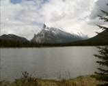 Stock Video Footage of Mount Rundle as seen from Vermilion Lakes on a grey day, Banff National Park