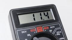 Measuring voltage with multimeter Stock Footage