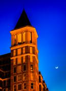 Stock Photo of top of the building and a moon at night in washington, dc.